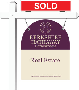 Berkshire Hathaway HomeServices Yard sign with red sold sign rider